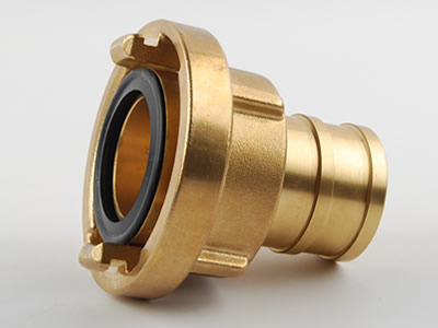 Side face of brass storz suction hose coupling which can see projecting lugs, seal and tube.