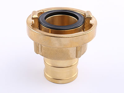 A brass storz suction hose coupling in negative which can see projecting lugs and seal.