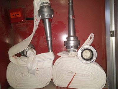 Two pieces of fire fighting hose with storz suction hose coupling and a long tube.