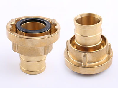 A brass storz suction hose coupling in positive and negative.